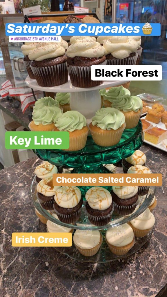 Black Forest, Key Lime, Chocolate Salted Caramel and Irish Creme cupcakes stacked on our counter at cAKe